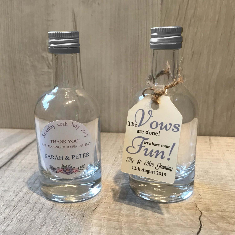 miniature clear glass flip top bottles